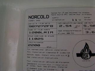 USED RV MOTORHOME REFRIGERATOR | NORCOLD 1200LRIM (WOOD PANEL)  REFRIGERATOR